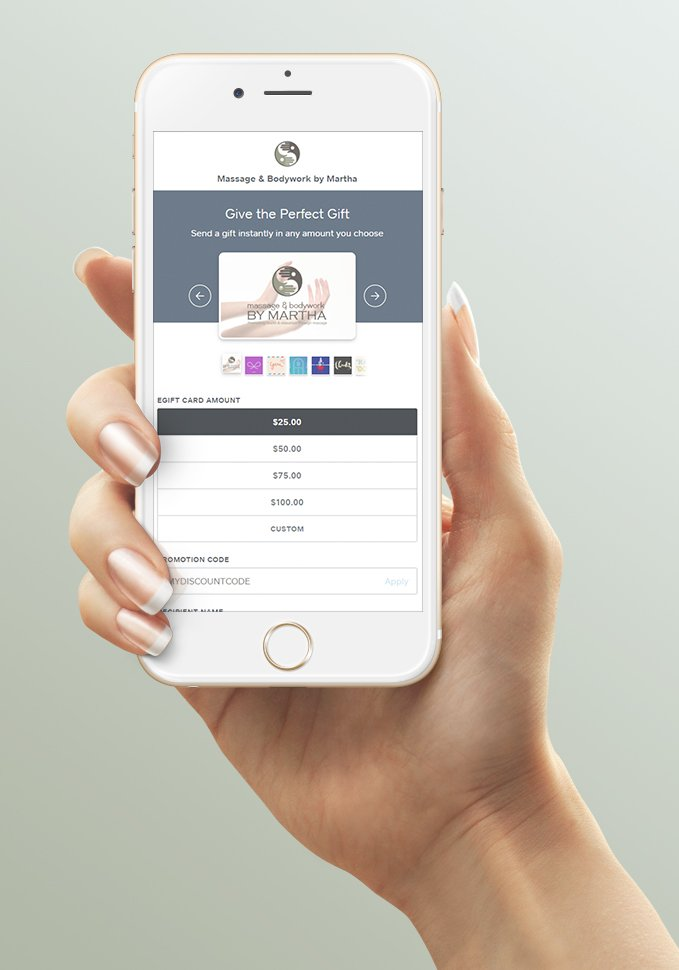 Hand holding mobile phone showing egift card landing page