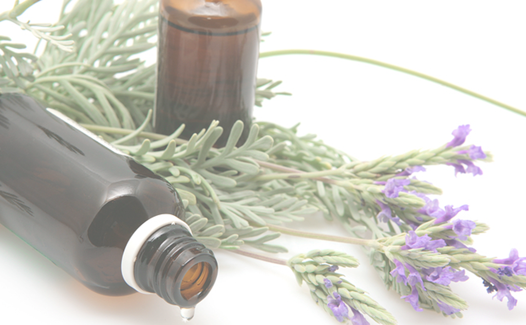 Essential oil bottles and sprigs of lavendar